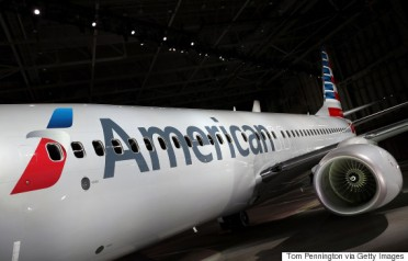 DALLAS, TX JANUARY 17: American Airlines unveils a new company logo and exterior paint scheme on a Boeing 737 800 aircraft on January 17, 2013 in Dallas, Texas. The exterior changes are the first for the company since 1968 and were announced as the parent company of American Airlines, AMR, is considering a merger with US Airways. (Photo by Tom Pennington/Getty Images)